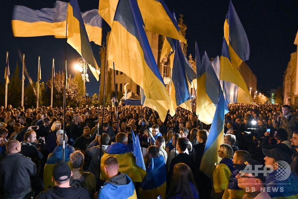 ウクライナ和平へ基本合意、東部への「特別な地位」付与に抗議デモ