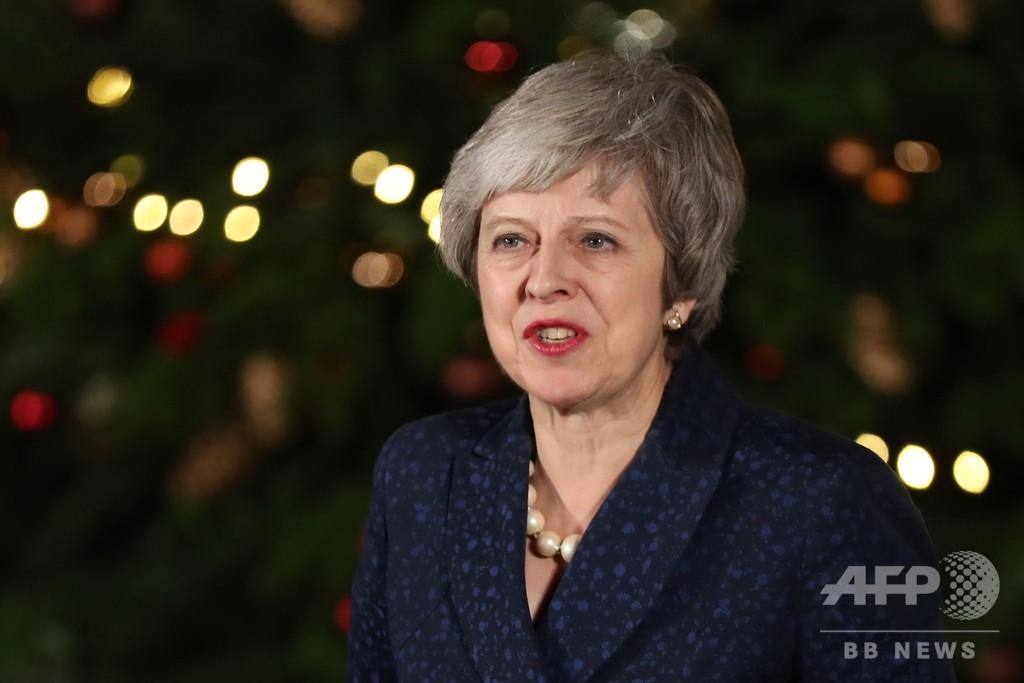 メイ英首相、与党で信任獲得 反対も3分の1、離脱案承認なお険しく