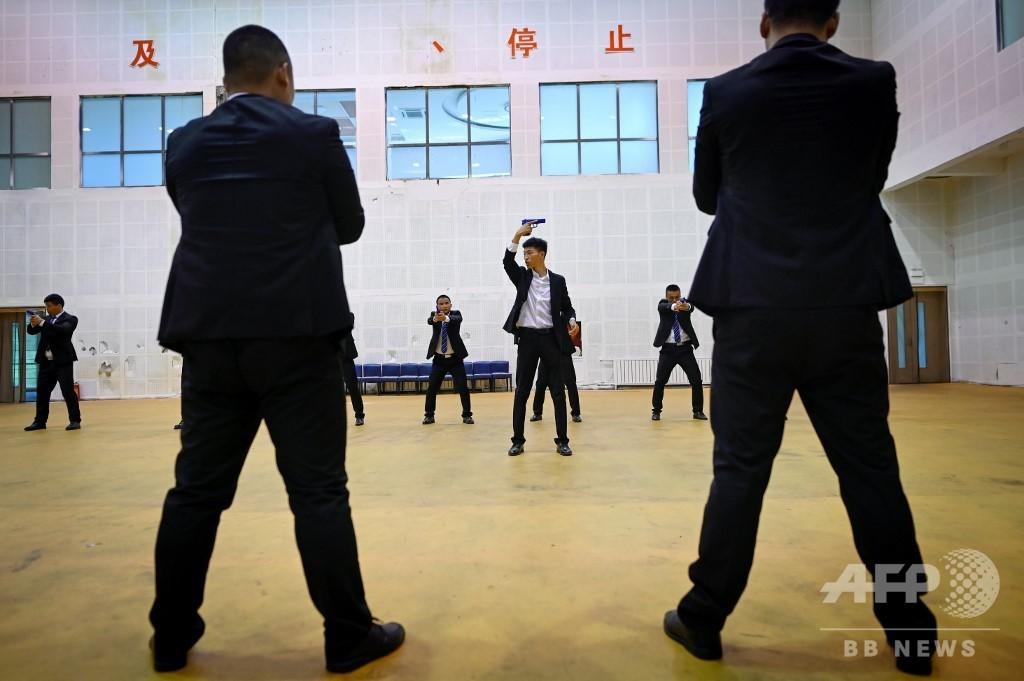 目指せ、中国新富裕層のボディーガード デジタル防衛は必須技能