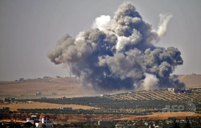 シリア政権軍、南部の反体制派に「最大規模」の空爆 降伏拒否受け
