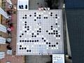 ちびっこ棋士が巨大囲碁を抱えて対局 洛陽で中国囲碁大会