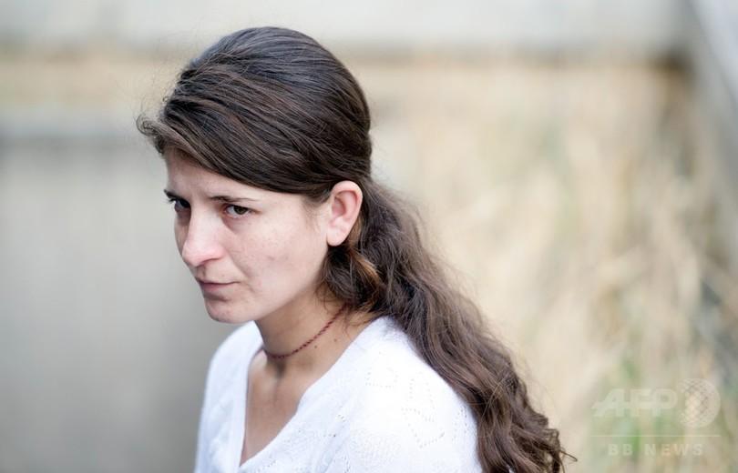 「青い目のヤジディーをくれ」 捕らわれの10代女性が見たISの奴隷市場
