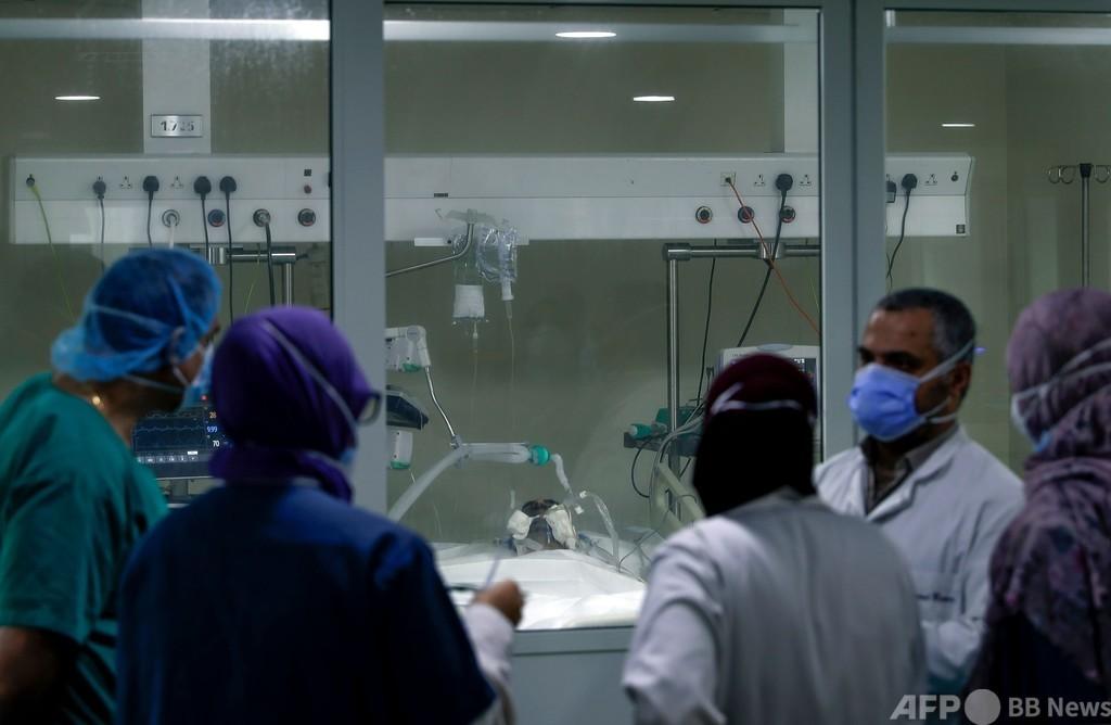 世界の新型コロナ死者、130万人超える AFP集計