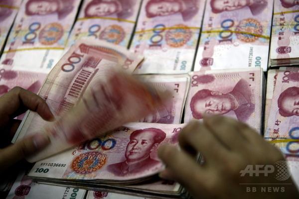 中国、金の輸入と人民元の流出を制限