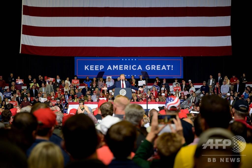 米大統領選まで1年、深まる分裂と広がる「怒り」