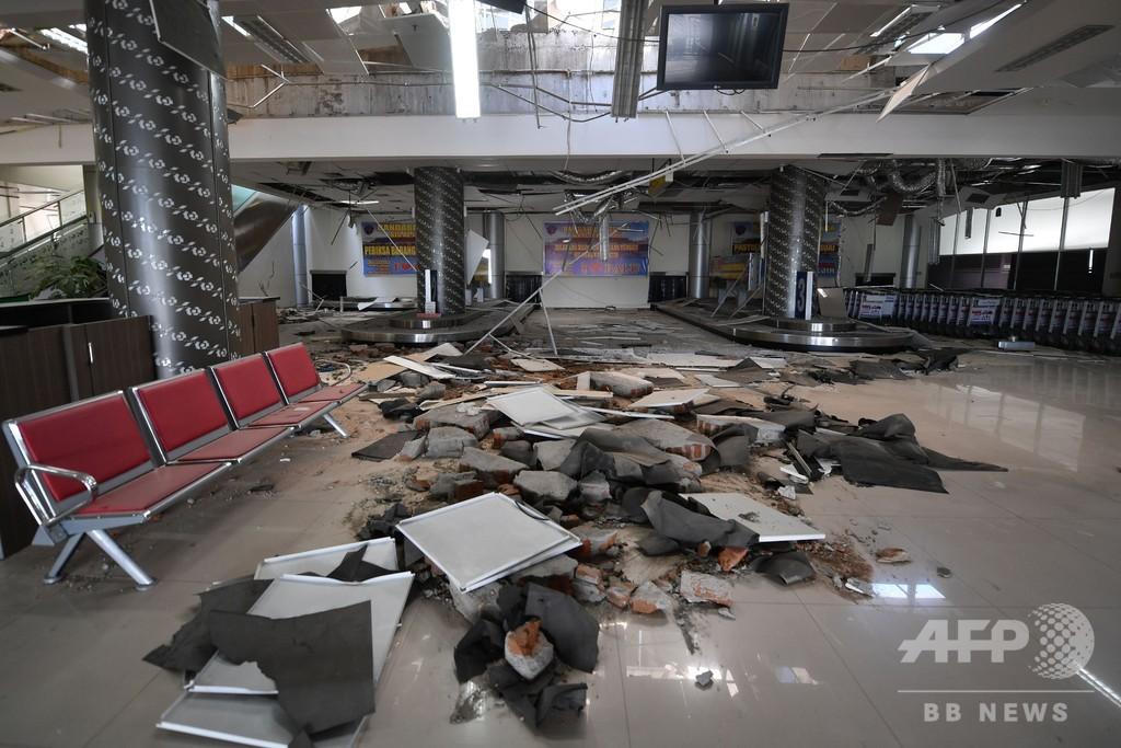 地震の中で決死の管制、殉職した男性に称賛の声 インドネシア