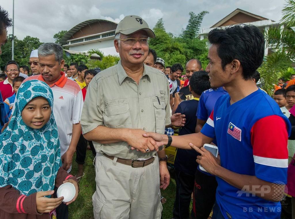 マレーシア首相が細菌感染、洪水被災地視察後に