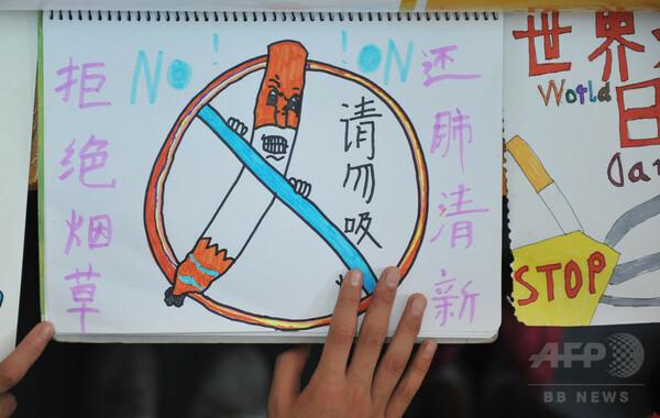 中国の喫煙に起因する死者、30年までに年200万人 研究