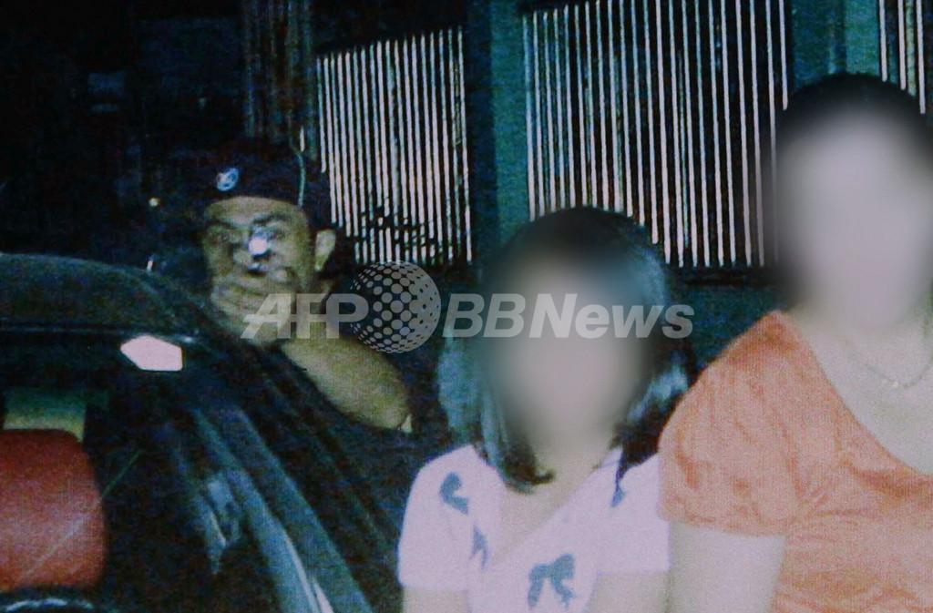 殺される直前にシャッター切った議員、写っていた犯人 フィリピン