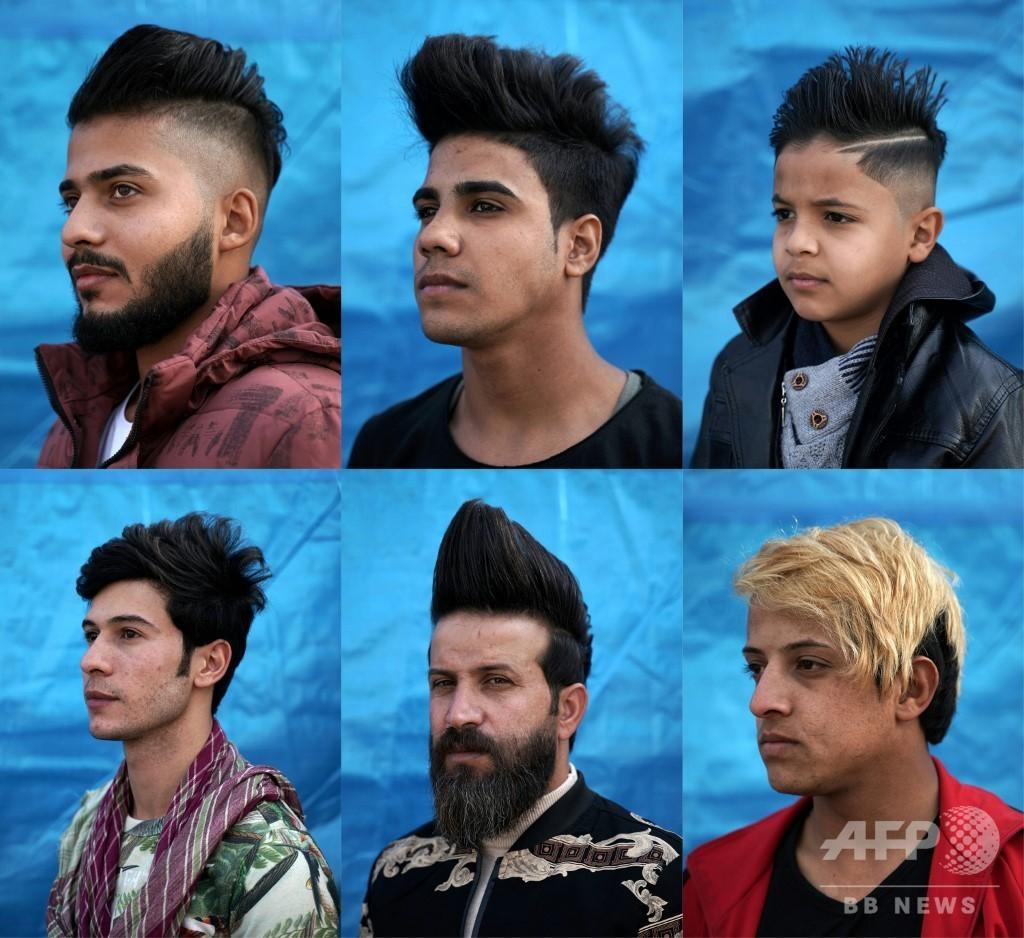 「革命の場」で反骨精神示す髪形が流行 反政府デモ続くイラク