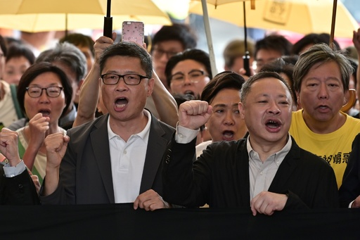 香港、「雨傘運動」デモ発起人に禁錮1年4月の実刑判決