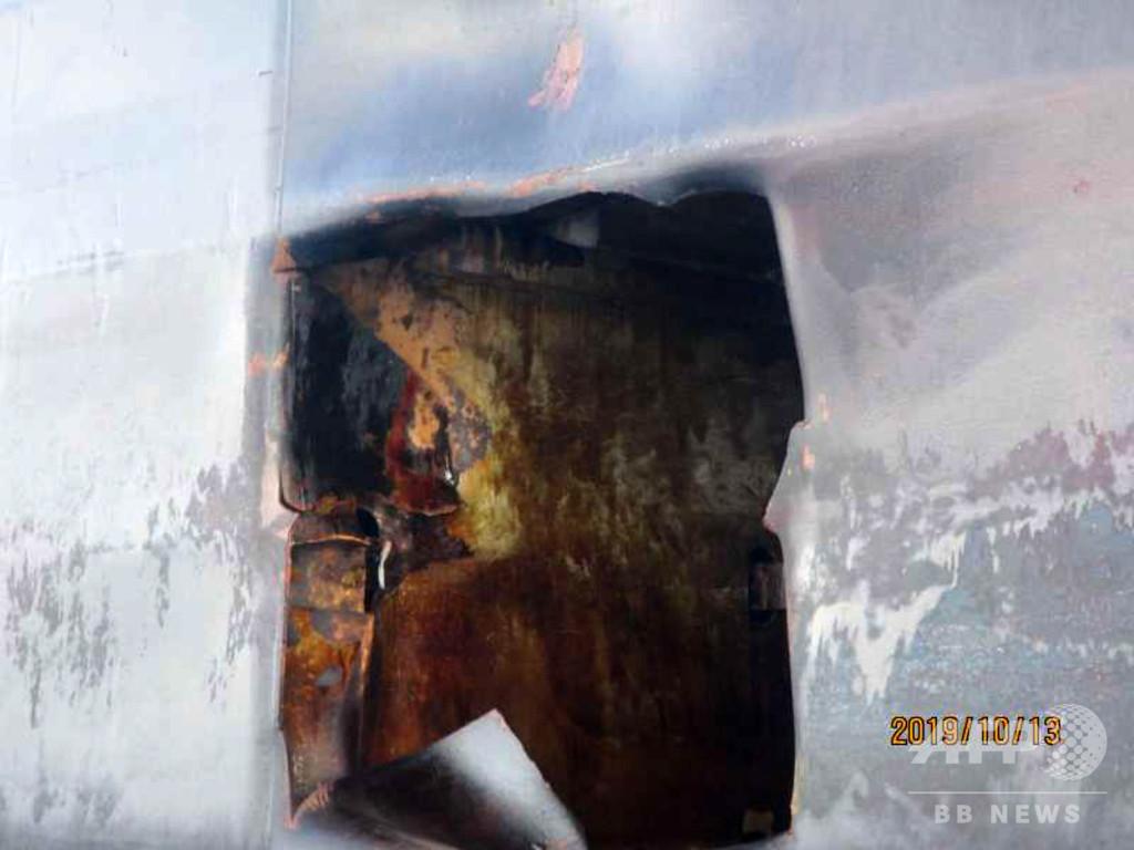 タンカー攻撃、イランが外国政府の関与主張 損傷の写真公開