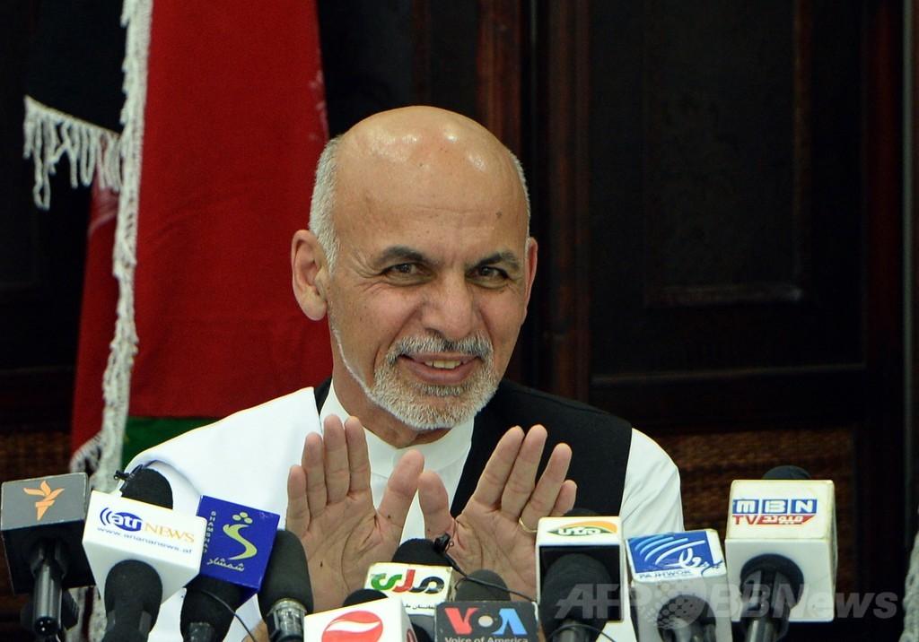 不正疑惑のアフガン大統領選、暫定勝利はガニ氏