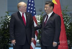 中国の習主席、トランプ氏に北朝鮮情勢で抑制求める グアムは防衛準備整う