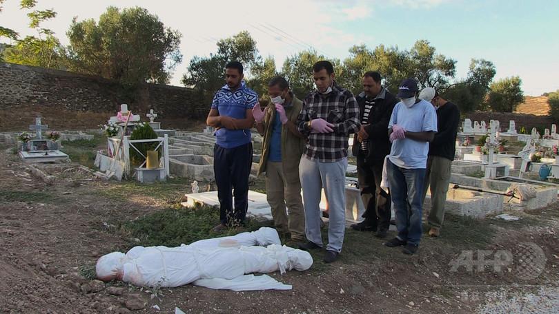 AFPTV記者、難民危機報道でロー...