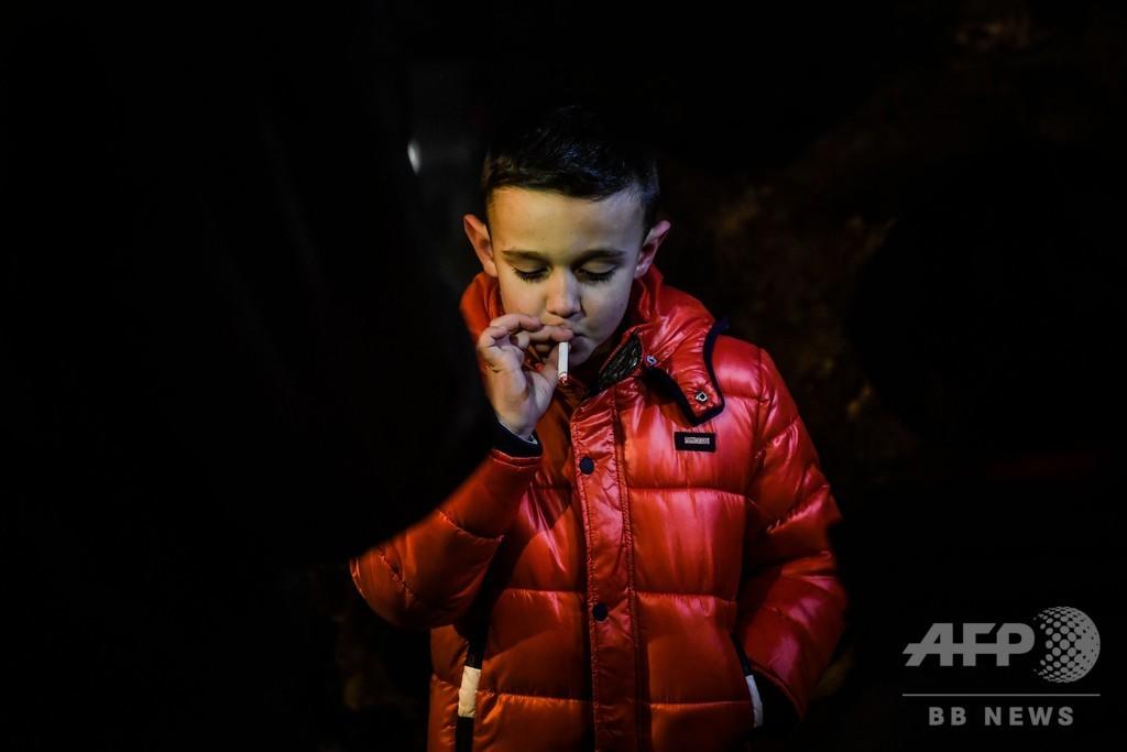 たばこを吸う子どもたち、ポルトガルの公現祭