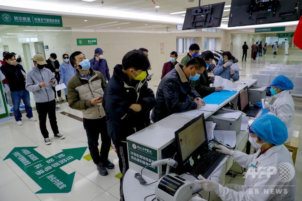 勤務再開に向け新型ウイルス検査、14万人が実施 中国・武漢