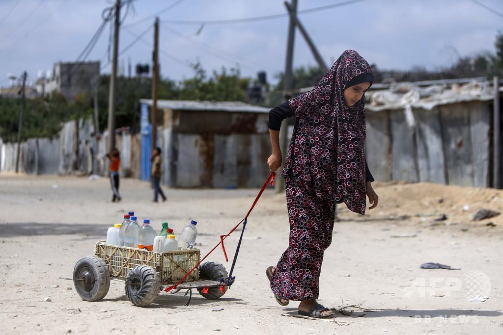 【今日の1枚】変わらぬ日課、飲み水を運ぶ少女