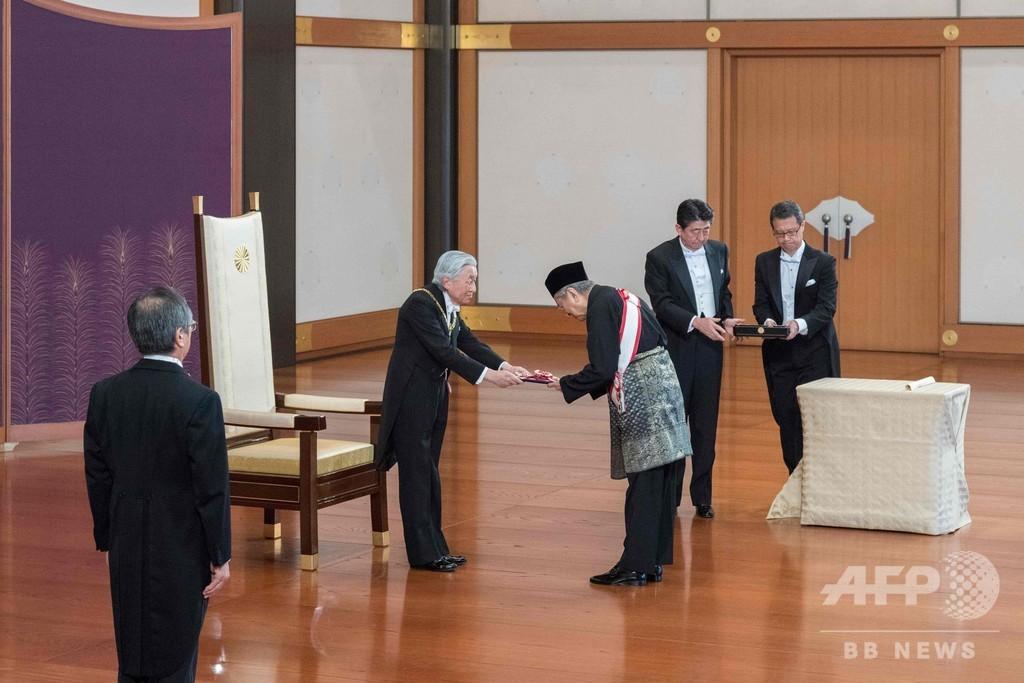 トランプ大統領の心臓に矢を射るマハティール首相