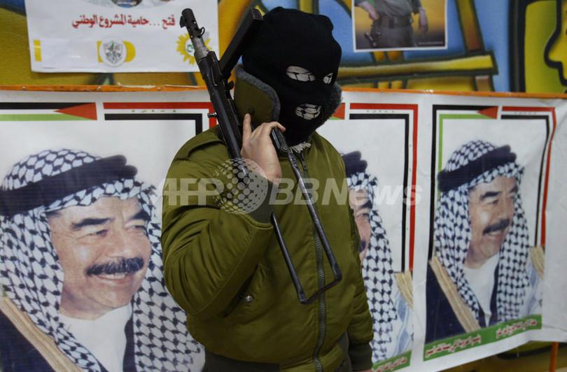 ファタハ系武装組織が集会、元大統領の死刑執行を受けて - パレスチナ自治区