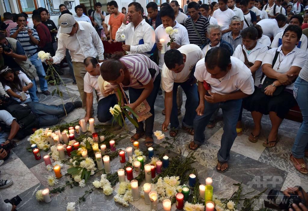 地中から発見の28遺体、失踪の学生含まれず メキシコ