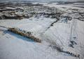 ロシア機墜落、降り積もる雪の中で現場検証続く