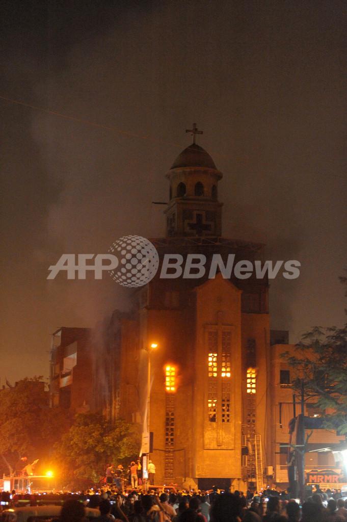 カイロでコプト教会をイスラム教徒が襲撃、両教徒の衝突で9人死亡