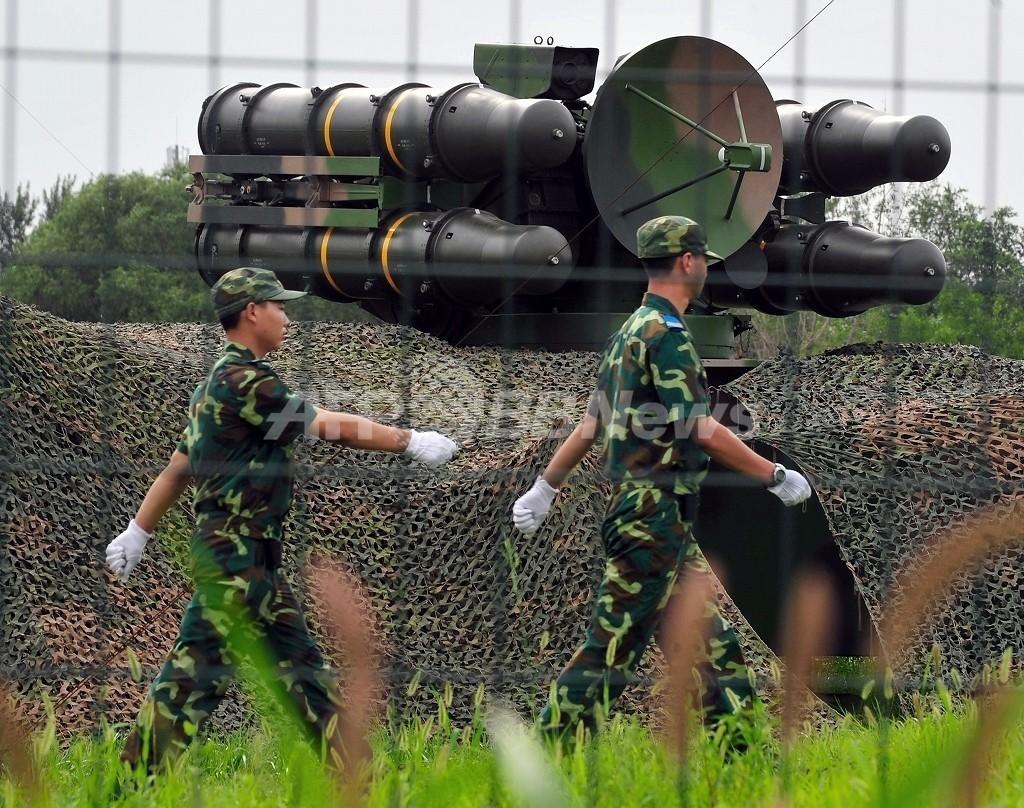 兵士3万人超に戦闘機と軍艦、テロ厳戒態勢の北京五輪