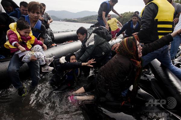 EU、難民12万人の受け入れ分担決定 一部の反対押し切る