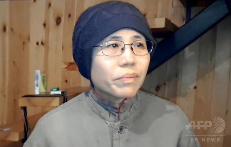 故劉暁波の妻劉霞氏、飛行機で中...