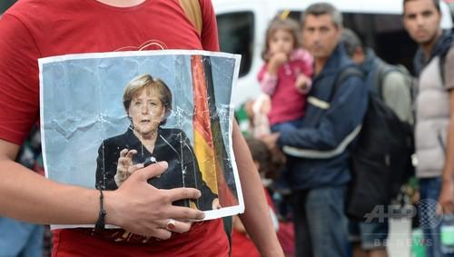 ドイツ、移民流入による今年の経済負担予測1兆3200億円
