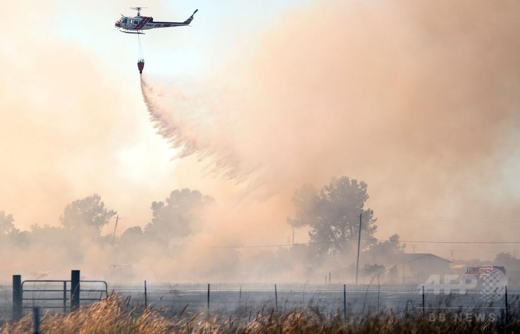 北米で山火事拡大、1万8000人避難 カナダの州が非常事態宣言