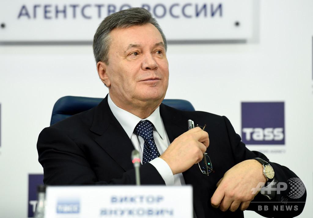 ウクライナ前大統領に国家反逆罪で禁錮刑 被告不在で言い渡し