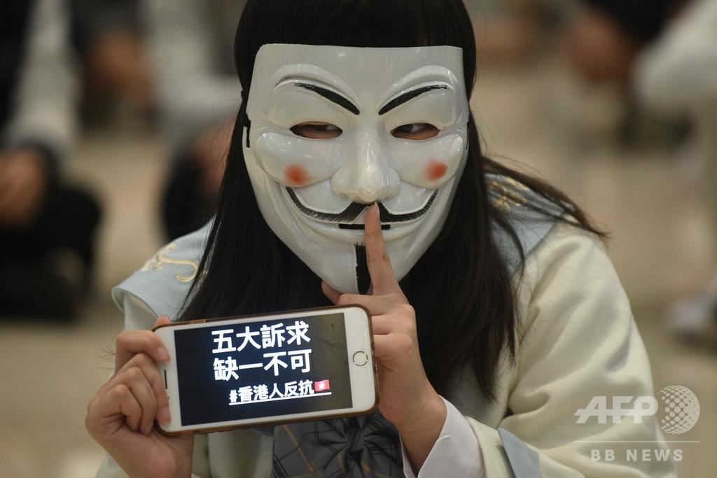 覆面禁止「違憲」判決、執行を7日間停止 香港高裁