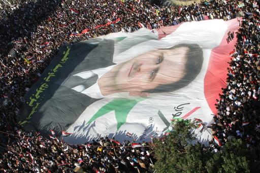 シリア内戦4年目、攻勢強めるアサド政権