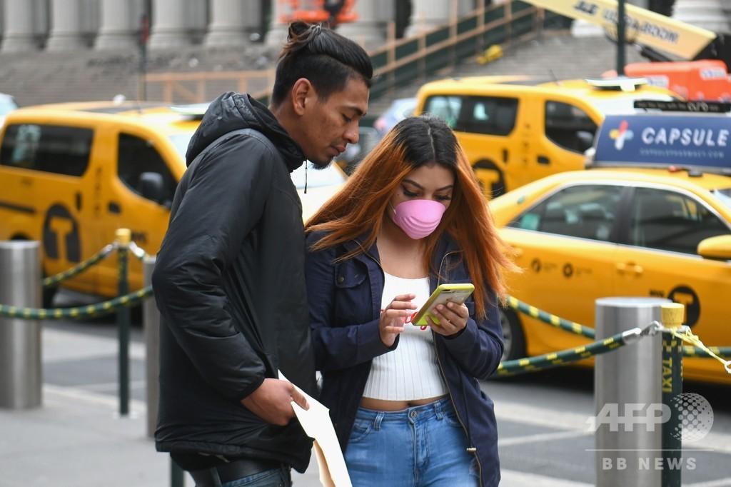 「マスク不要」のスタンスに変化か、新型コロナ拡散防止で 米国