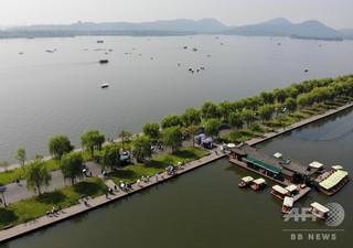 国慶節前に中国の観光施設が値下げラッシュ 一部施設は無料化も