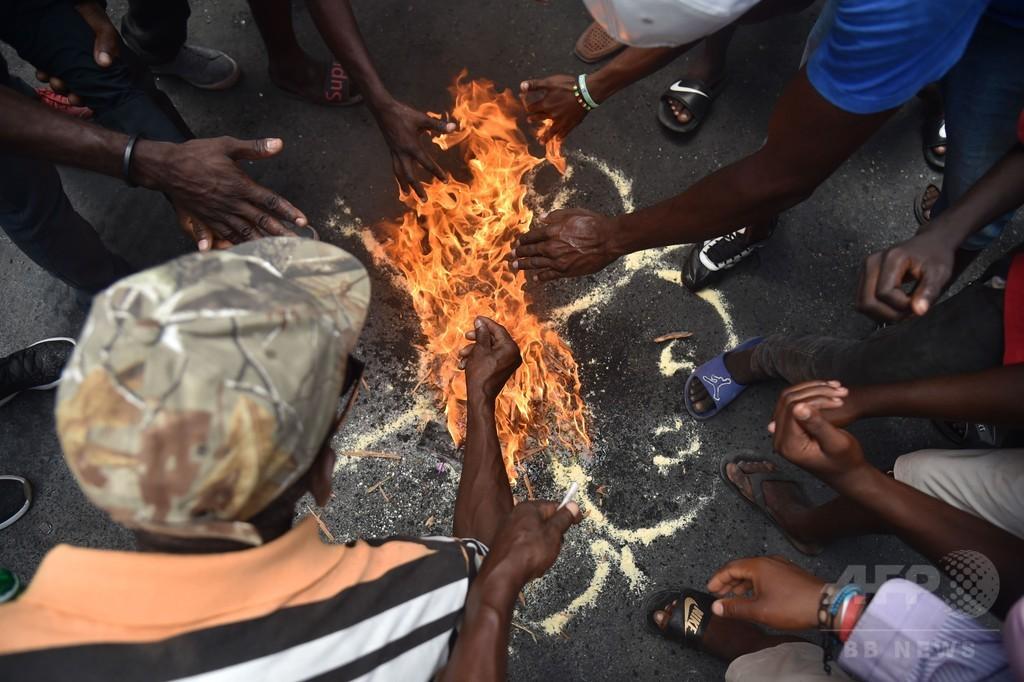 ハイチ首相、抗議デモの暴徒化受け辞任 燃料価格引き上げは中止