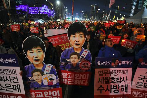 朴氏の退陣求める集会で僧侶が焼身自殺図る 韓国