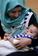 手足8本で生まれた赤ちゃん、4本の切断手術に成功 インド