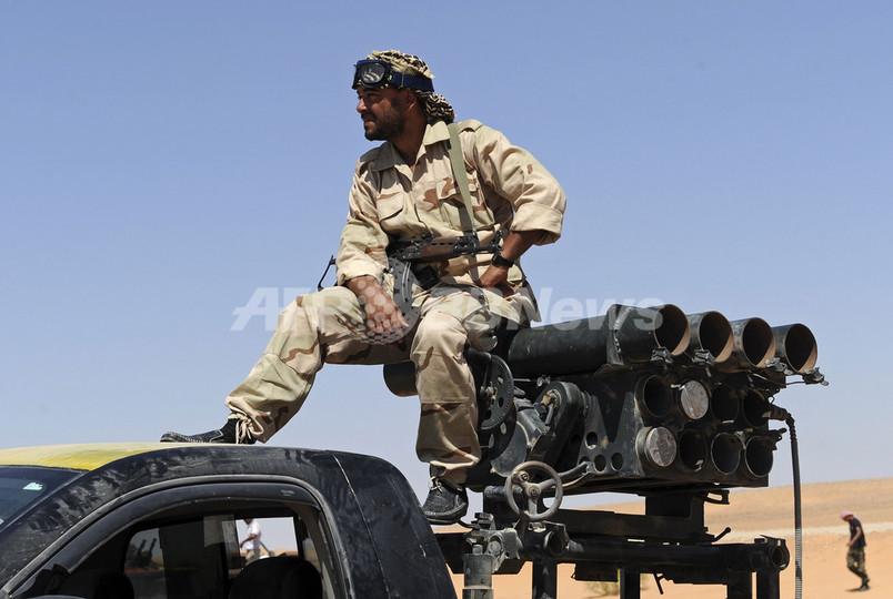 反カダフィ派とカダフィ軍の戦闘続く、大佐三男はニジェール入り リビア