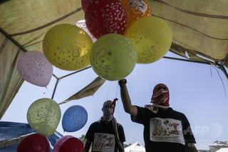 パレスチナの「燃える風船」作戦にイスラエルが反撃、2人負傷 ガザ地区