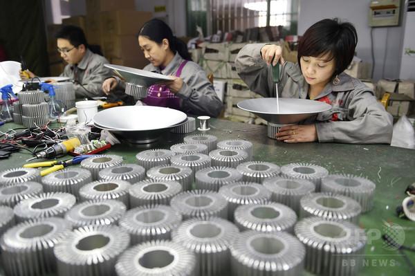 中国GDP、14年は7.4%増 24年ぶり低水準
