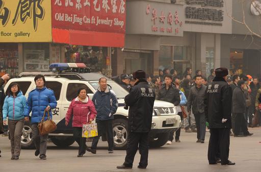 中国国営メディア、抗議デモ呼びかけを批判