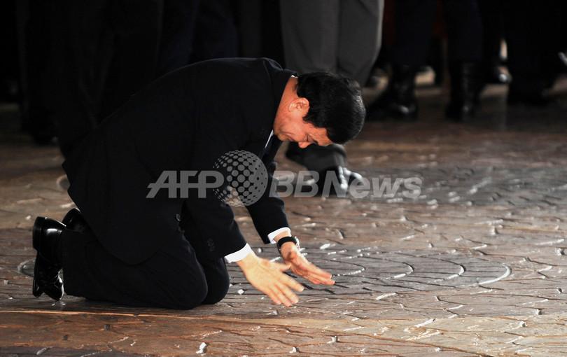 タクシン元タイ首相が帰国、17か月ぶり亡命生活に終止符