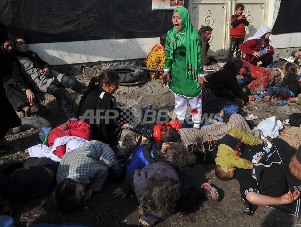 「気づけば死体の真ん中に」、自爆現場に居たAFP写真記者 インタビュー