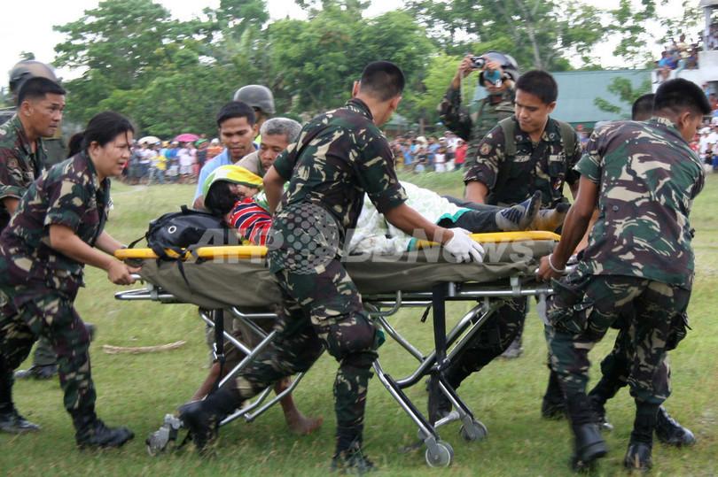 フィリピン南部で地滑り、懸命の捜索続く