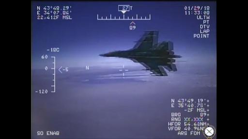 動画:ロシア戦闘機、黒海上空で米海軍偵察機と「ニアミス」