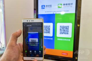 765af6f12abb 【3月28日 東方新報】中国西部の一部のウォルマート( WalMart )店舗で、アリペイ( Alipay )による支払いができなくなっている。