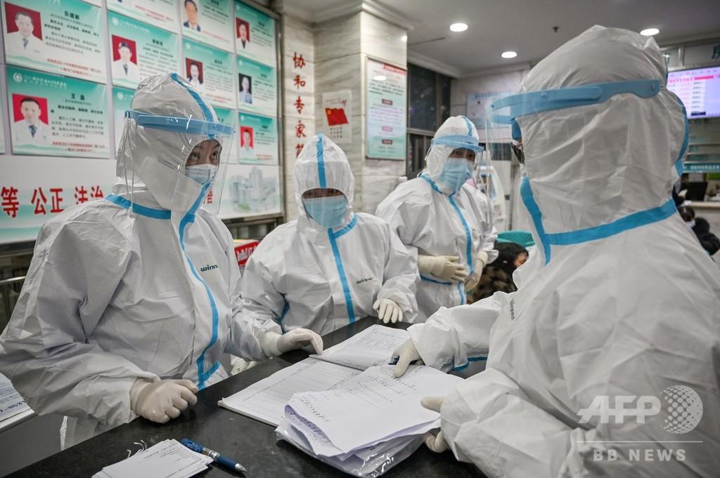 防護服の使い回しも…疲弊する医師ら、新型コロナウイルスとの闘い 中国